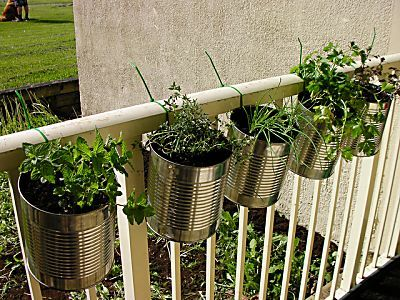 Save your coffee cans to make a hanging herb garden