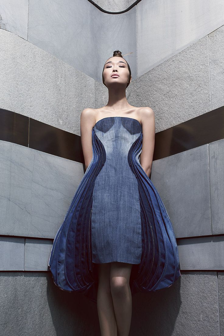 #Reconstructed sculptured dress made with secondhand jeans. The EcoChic Design Award Finalist Designer: Xinyan Dai   利用二手牛仔褲重新構造成的雕刻洋裝。時裝設計師: 戴歆彥 #ecochicdesignaward Photographer: Tim Wong, Stylist: Denise Ho