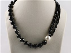 Faceted black agate & white sea shell asymmetrical necklace