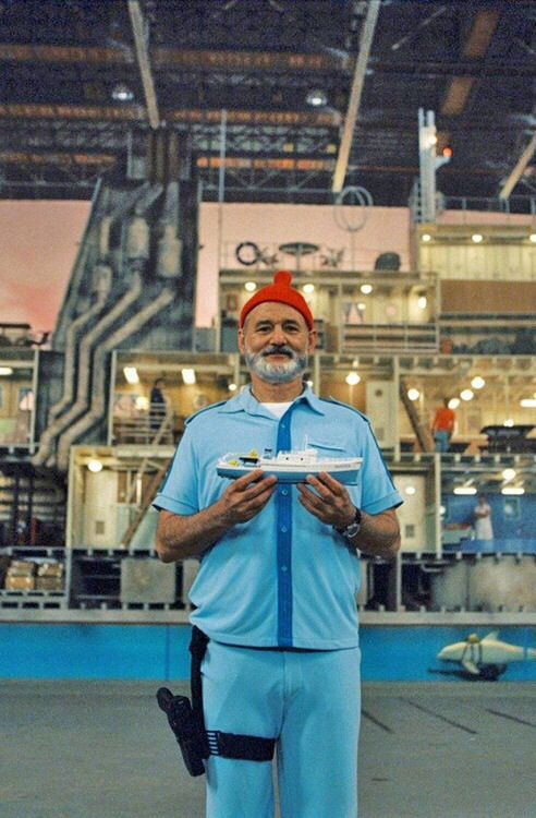the Life Aquatic with Steve Zissou--love the powdery blue for walls with some red accents throughout the apartment