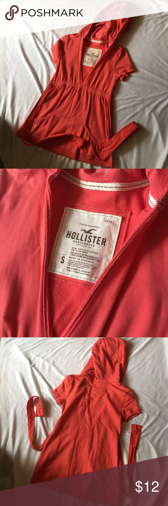 Vintage Hollister Short Sleeve Sweatshirt This is a gorgeous rare vintage short sleeve sweatshirt from Hollister. It is perfect as a shirt with a camisole underneath and ties in the back with a bow. There is some piling and minor discoloration as shown in the last picture. The color is a peachy pink and truest to the last picture. Hollister Tops Sweatshirts & Hoodies