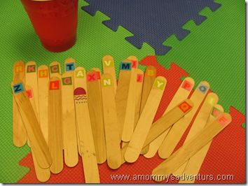 Sound sticks/letter sticks. When child picks up a stick they say sound and/or name  that matches the letter. Can use them to make cvc words.  Could use bottle tops instead.
