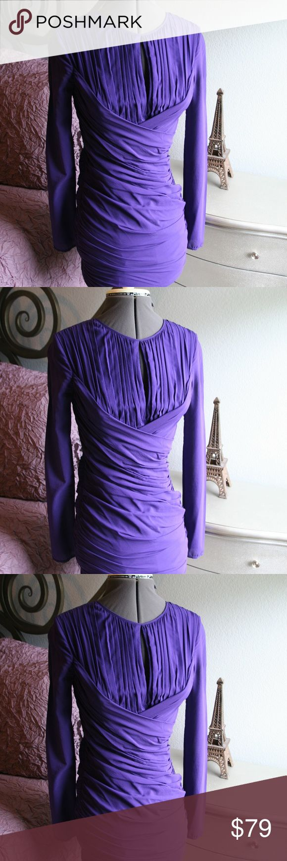 Jill Stuart Purple Cocktail Dress Worn once!  Make this your new holiday classic.  Purple Jill Stuart cocktail dress, size 2. Sheer illusion sleeves give it on-trend flair. Ruched bottom half is super-flattering. Some statement earrings and heels, and you're good to go to your next night out, holiday party, girl's night out, etc. Jill Stuart Dresses Long Sleeve