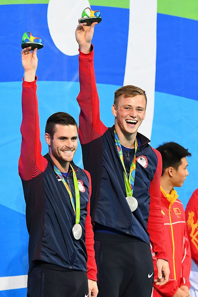...and silver medalists David Boudia and Steele Johnson of the US happily…