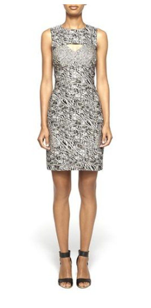 Nicole Miller Women's Animal Print Dress, Size 4. With an overall Zebra and Leopard pattern, this dress is flattering and a bit wild! Figure hugging jacquard sheath dress with cut out in front and back. Back exposed zipper. Brand: Nicole Miller Fiber Content: Jacquard, cotton, polyester.