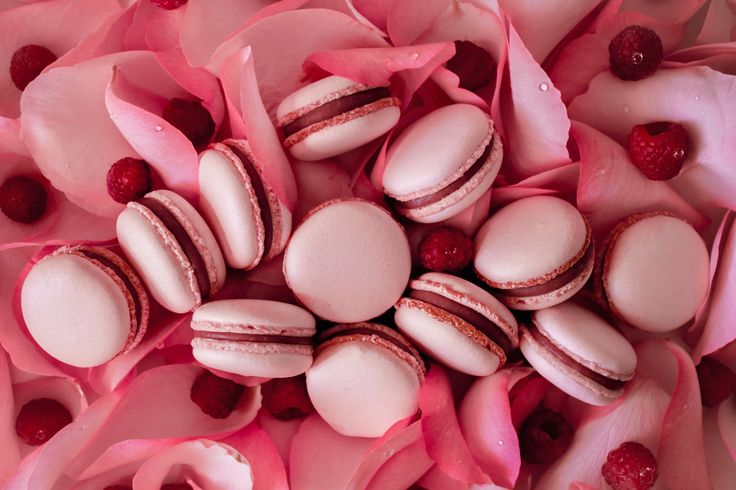 Macarons with white Valrhona chocolate ganache, raspberries and rose water.