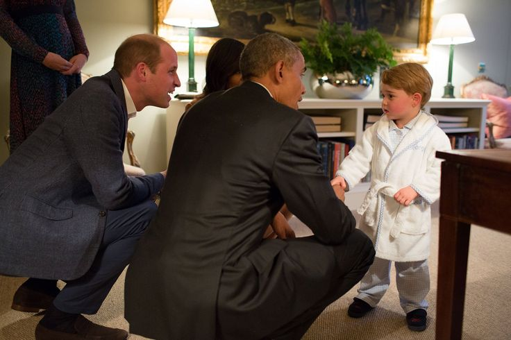 President Barack Obama, Prince William, Duke of Cambridge, and First Lady Michelle Obama talk with Prince George at Kensington Palace on April 22, 2016, in London.