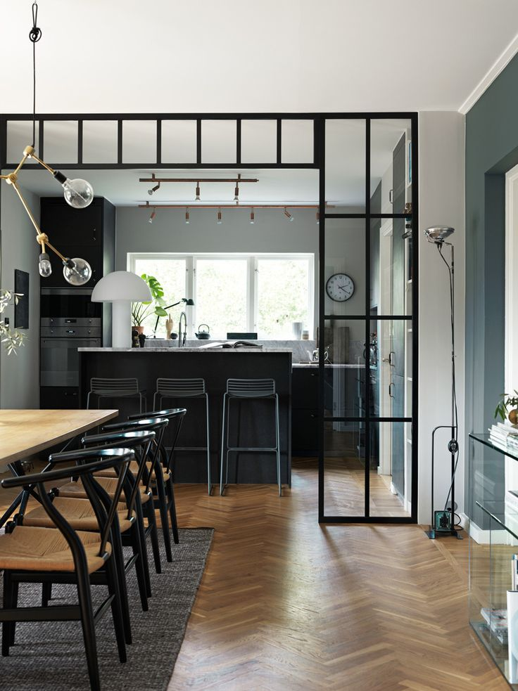 Kitchen with industrial glass wall