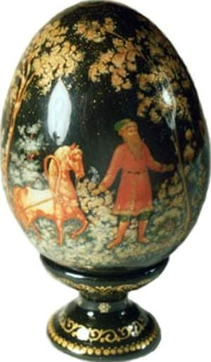 Wooden Easter egg is decorated with the traditional lacquer miniature from the Russian village of Palekh.