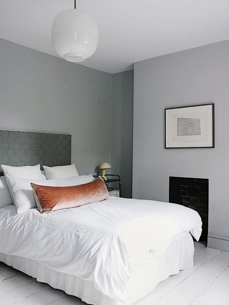 White bedroom with soft apricot accent pillow