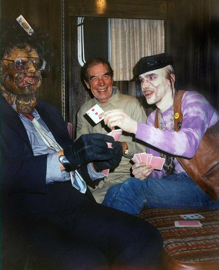 Bill Johnson, Jim Siedow and Bill Moseley playing cards on the set of The Texas Chainsaw Massacre 2.