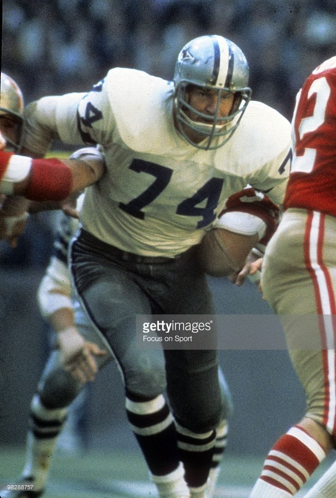 Defensive Tackle Bob Lilly #74 of the Dallas Cowboys breaks through the line going after quarterback John Brodie #12 of the San Francisco 49ers January 2, 1972 during the NFC/NFL Conference championship football game at Texas Stadium in Dallas, Texas. Dallas won the game 14-3. Thomas played for the Cowboys from 1970-71.