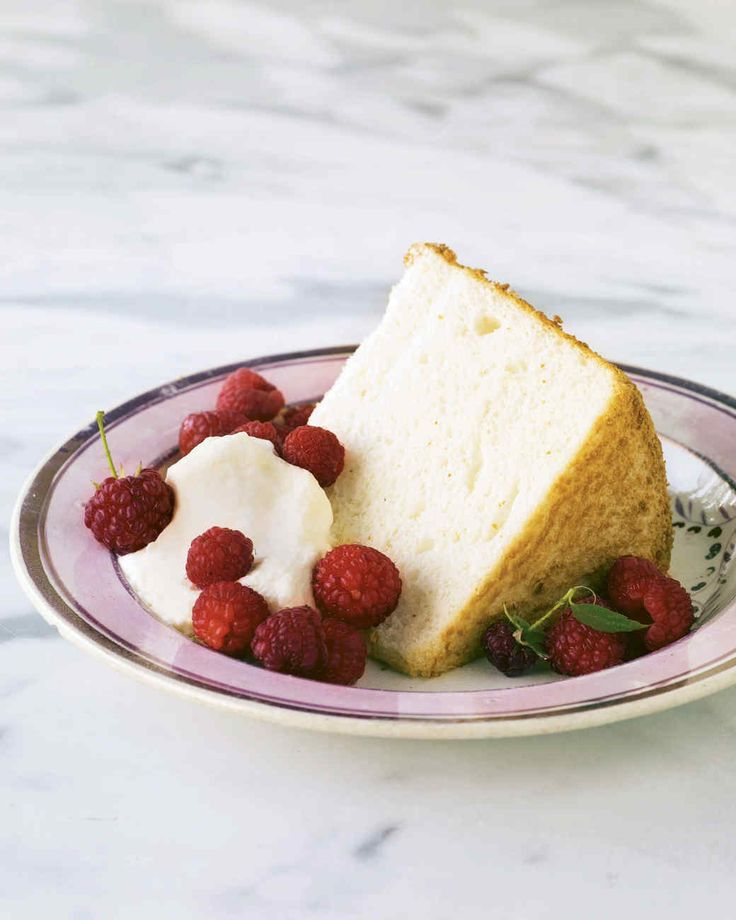 Classic Angel Food Cake   Martha Stewart Living - Soft and fluffy as a cloud in the springtime sky, this angel food cake is bathed in elderflower syrup for floral sweetness.