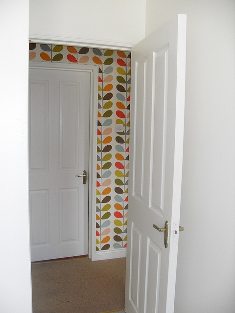This looks pretty fantastic, love the injection of colour from this Orla Kiely wallpaper