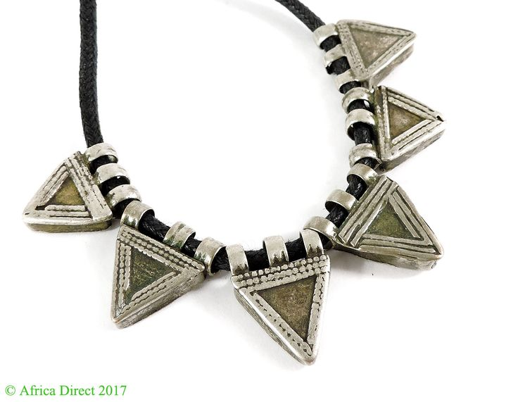Ethiopian Telsum Prayer Boxes, like most traditional Ethiopian jewelry, are worn as protective amulets. Specifically, these triangular pendants were worn to guard against the evil eye. Crescent-shaped pendants were worn to guard against the crescent moon. http://www.africadirect.com/beads/african-under-100/6-ethiopian-telsum-silver-prayer-boxes-africa.html #AfricanArt