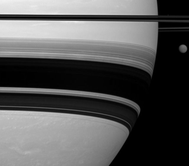 Saturn's rings cast a shadow with Titan in the background.: Moon Titan, Rings Casting, Titan Looms, Shadows Rings, Photo