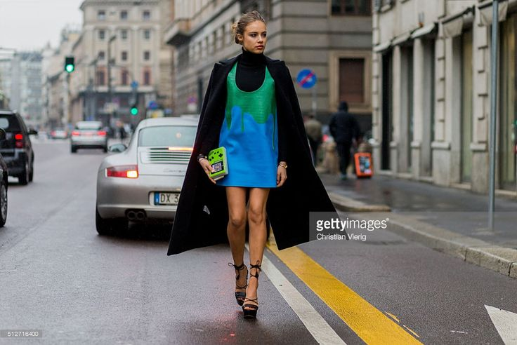 Xenia Tchoumitcheva wearing a Pinko coat, Au Jour Le Jour dress and Elisabetta Franchi heels seen outside Blumarine during Milan Fashion Week Fall/Winter 2016/17 on February 27, 2016 in Milan, Italy. Urania Gazelli Game Over clutch bag plexiglass