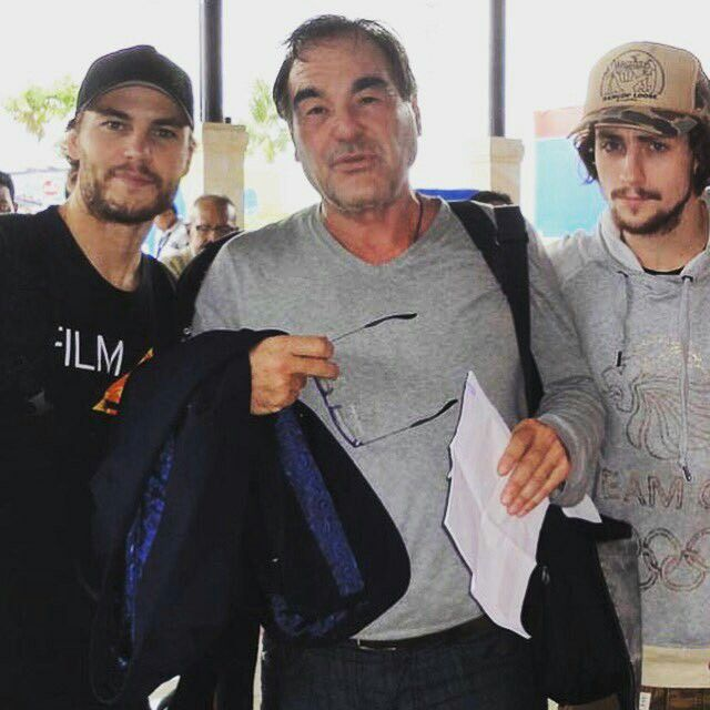"""Taylor Kitsch with Oliver Stone and Aaron T. Johnson by movie """"Savages""""."""