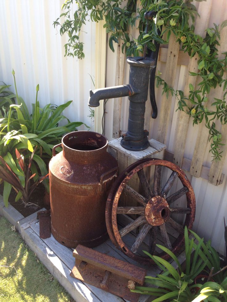 Old milk jug with a old pump I used a solar pump for the pump sitting on a old pallet great feature for your garden