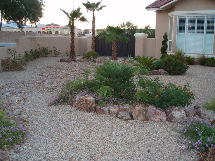 The little island of plants is nice in this Las Vegas yard. Notice how different sizes of gravel and rocks were used to create texture and interest.
