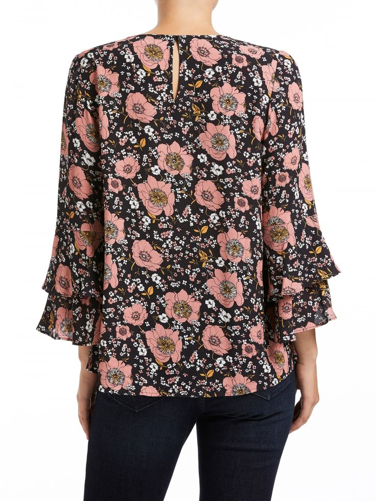 Featuring: - Exclusive print - Double ruffle sleeve detail - Centre back keyhole with button - High low hem