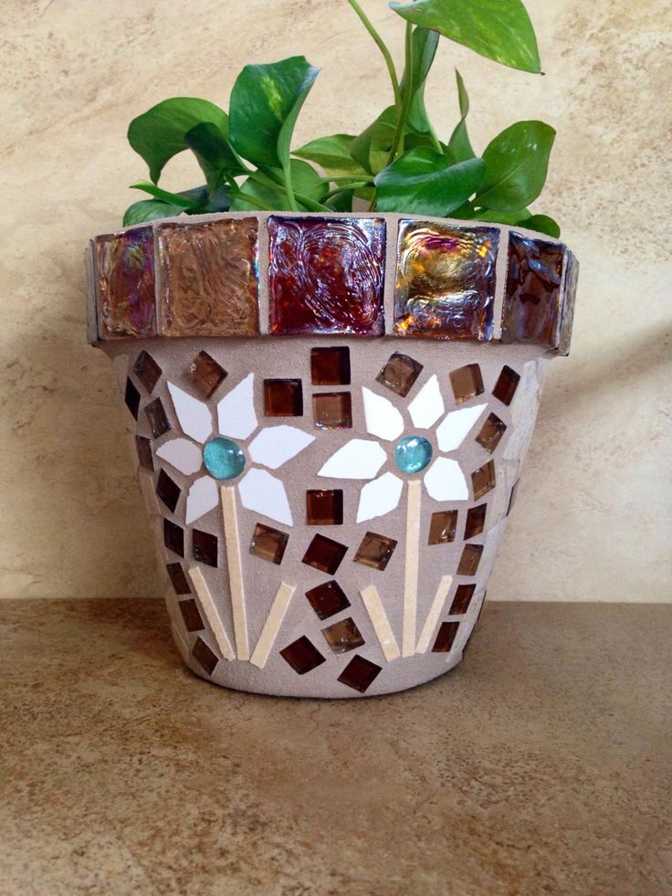 A personal favorite from my Etsy shop https://www.etsy.com/listing/464613036/rustic-mosaic-planter-large-flower-pot