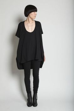 Oversize cotton jersey dress with curved hemline, longer in back. Scoop neck. Short batwing sleeves.
