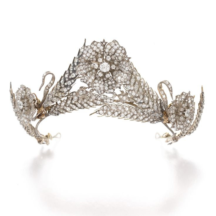 Diamond tiara, 1874 Of foliage design, composed of seven detachable ears of wheat and flower head motifs, each set with rose-, circular-cut, cushion-shaped and rose diamonds, length approximately 280mm, brooch, hair fittings and a pendant hook, fitted case stamped Mon Leriche Durand Succ.