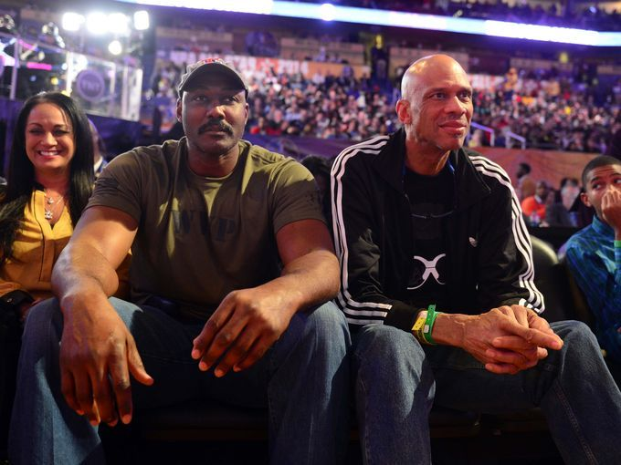 NBA legends Karl Malone, right, and Kareem Abdul-Jabbar take in the scene inside the Smoothie King Center.