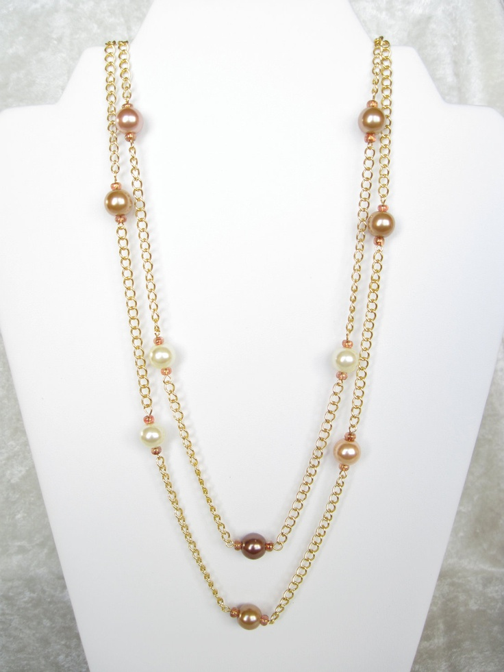 """An extravagant 60"""" long, this pearl stations necklace is as versatile as you will find. Lustrous 10 mm pearls in bronze tones glow at intervals along its length; the chain has been color-stabilized to prevent tarnishing. Wrap it around your throat three times for a rich look; wear it long for drama!"""