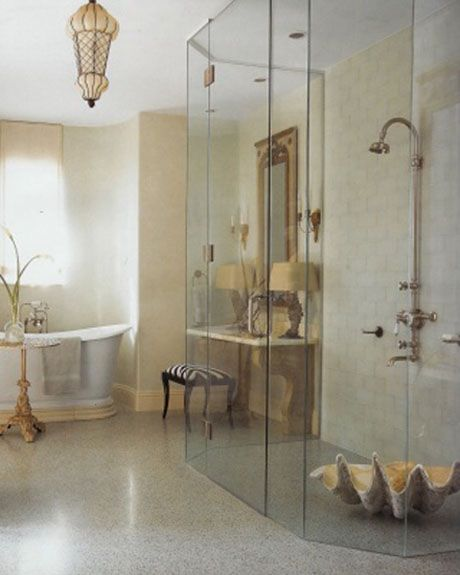 This is a bathroom by Barry Dixon. I love the neutral colors, zebra ottoman and giant clam shell in the shower.