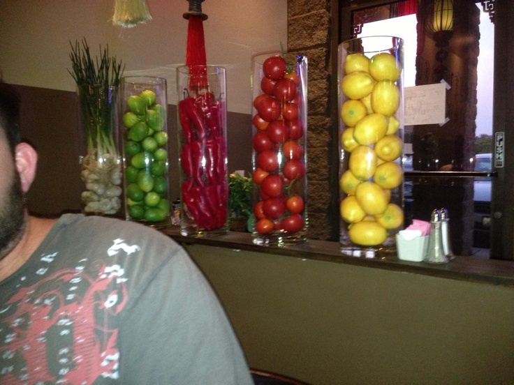 Clear Tall Cylindrical Vases With Fruit Inside. Peppers For The Man Too ;)