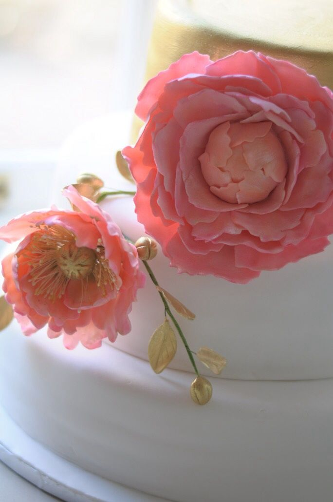 Floral detail of handmade sugar flowers for a wedding cake.
