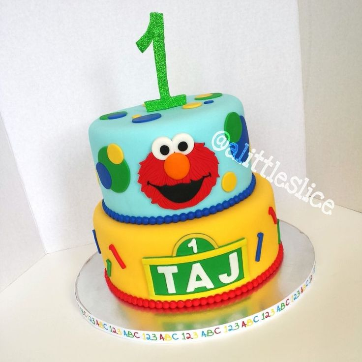 Elmo/Sesame street themed cake for a one year old boy made by Christina Pagan & Yesenia Figueroa. Feeds 30-40 people. Find us: Facebook.com/alittleslice1 & on Instagram @alittleslice
