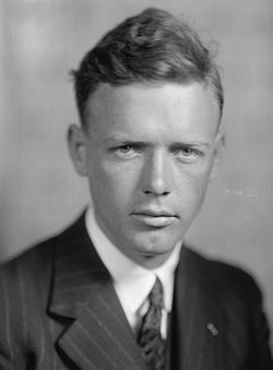 """Charles Augustus Lindbergh (February 4, 1902 – August 26, 1974) (nicknamed """"Slim"""",[1] """"Lucky Lindy"""", and """"The Lone Eagle"""") was an American aviator, author, inventor, explorer, and social activist.  As a 25-year-old U.S. Air Mail pilot Lindbergh emerged suddenly from virtual obscurity to instantaneous world fame as the result of his Orteig Prize-winning solo non-stop flight on May 20–21, 1927, Roosevelt Field located in Garden City on New York's Long Island to Le Bourget Field in Paris"""