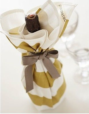 house warming gift - bottle of good wine and a beautiful kitchen towel
