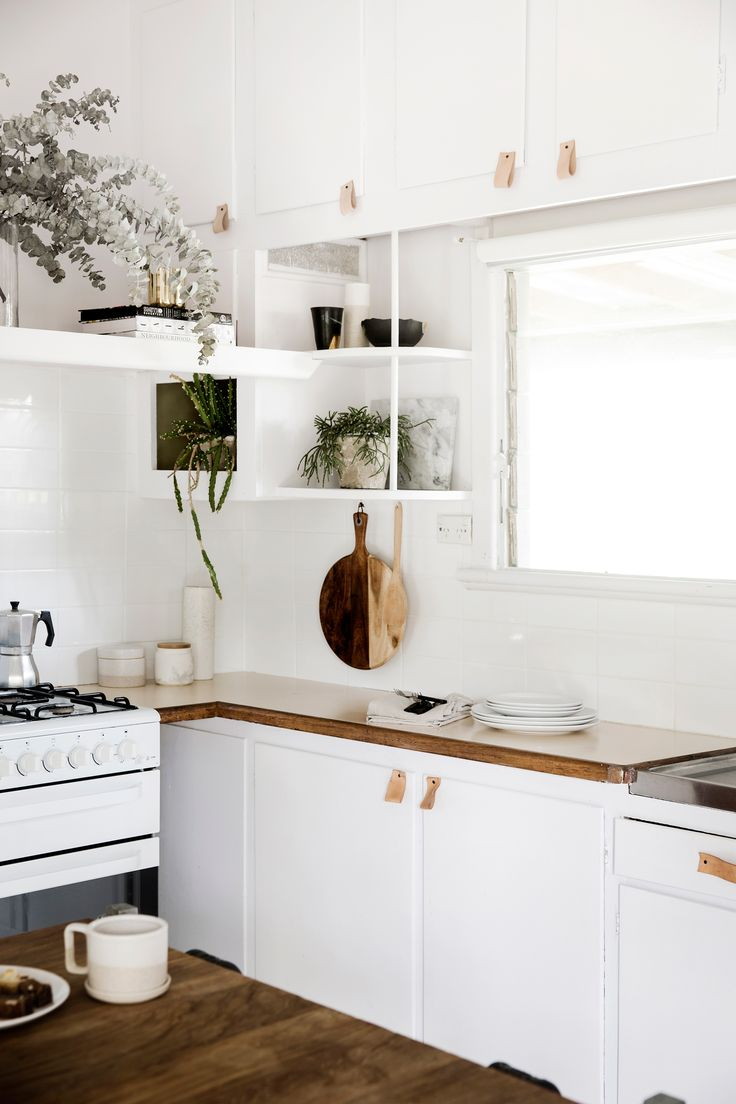 White kitchen from renovation of a 1950s beach shack on the Mornington Peninsula. Photography: Chris Warnes   Styling: Kerrie-Anne Jones