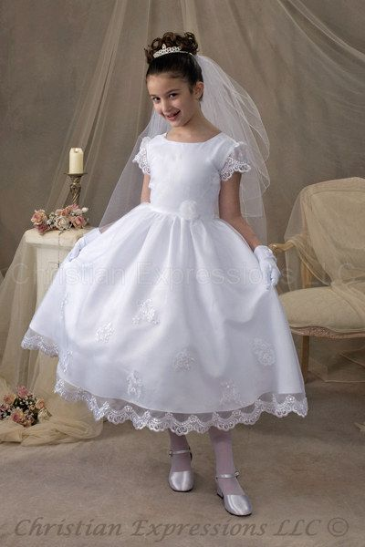 We both kind of like this one...first communion dress