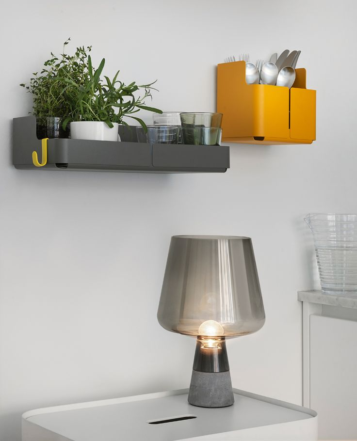 Iittala's Aitio storage objects by Cecilie Manz create a playful and practical visual entity on the wall. The multifunctional collection provides a final touch to the interior while storing important things to be at reach when needed. Grey Leimu lamp and white Vakka plywood storage boxes also by Iittala.