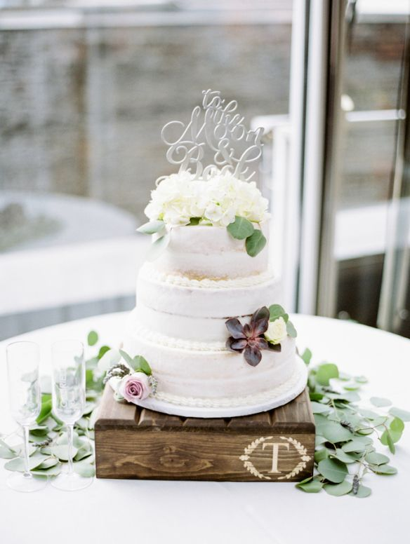 Christina Logan Design Photographer: Untamed Heart Photography  Cake: Kay McConfections  wedding cake, wedding cake table display, fresh flowers for cake, rustic wedding cakes