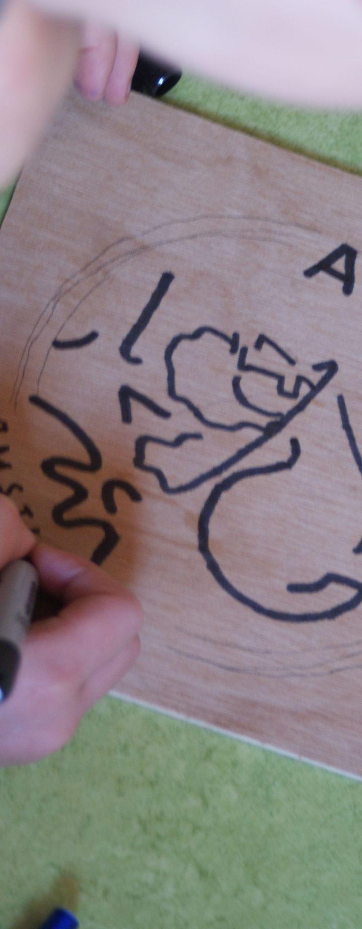 Ajax-logo op hout met carbonpapier - Kunjijook