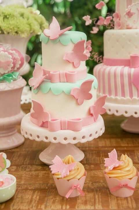 Cream and pink cake with pink butterflies