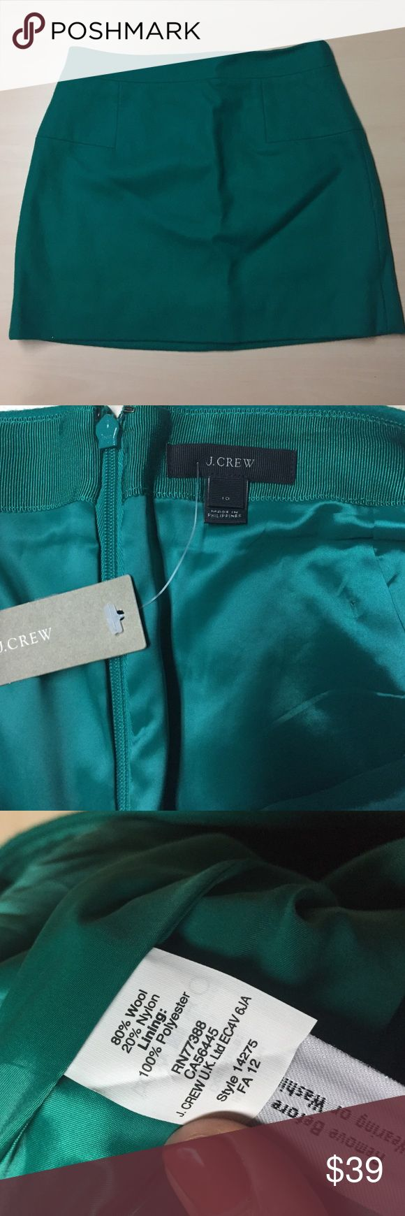 """NWT Bright Emerald Green Wool Mini - 10 NWT Bright Emerald Green Wool Mini - 10 / waist: 16"""" laying flat / 17"""" length/ 20"""" hips laying flat. Note that color is brighter than pictured, super gorgeous and vibrant green. J. Crew Skirts Mini"""