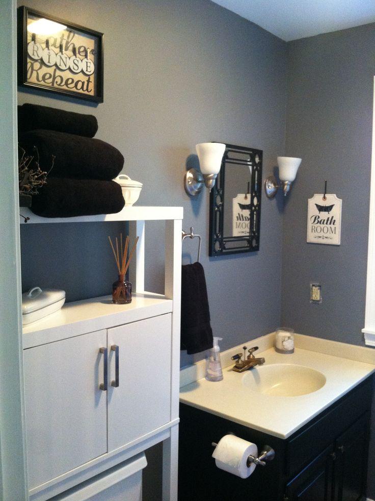 Small bathroom. Black, grey and white decor.