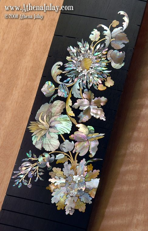 Fabulous mother of pearl inlay - now on a raspberry Schroeder chopper guitar.