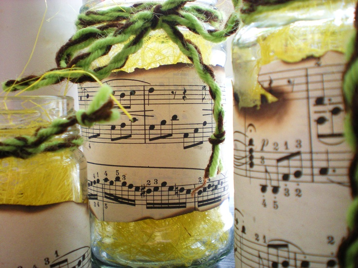 Home decoration with old music sheet and food cans made of glass :)