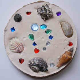 Garden Plaque craft using pie tin, Plaster of Paris, and treasures to press in.