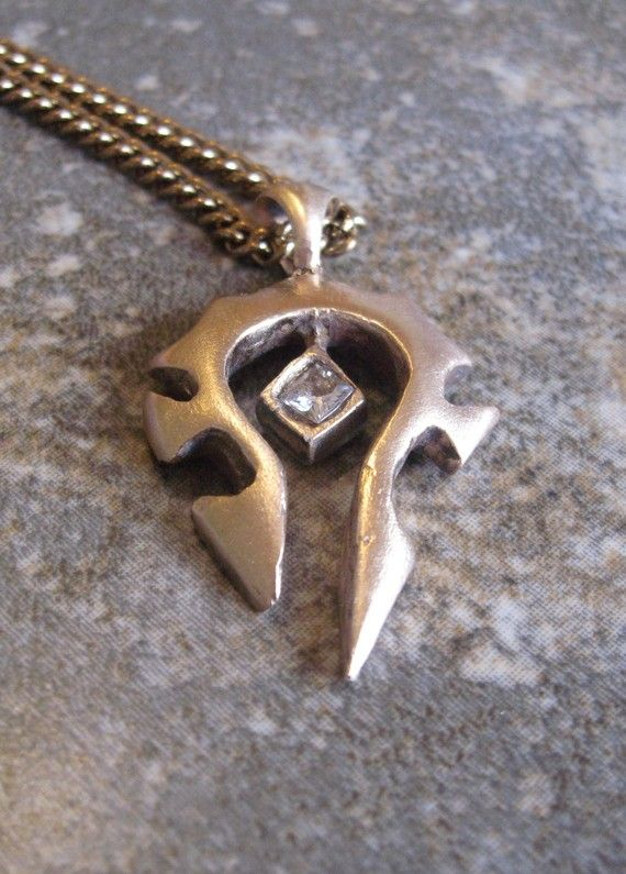 Would probably rock if I still played... Bronze World of Warcraft Horde Necklace. $40.00, via Etsy.