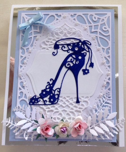 card made with spellbinders frame and tattered lace shoe.  www.delabur.co.uk