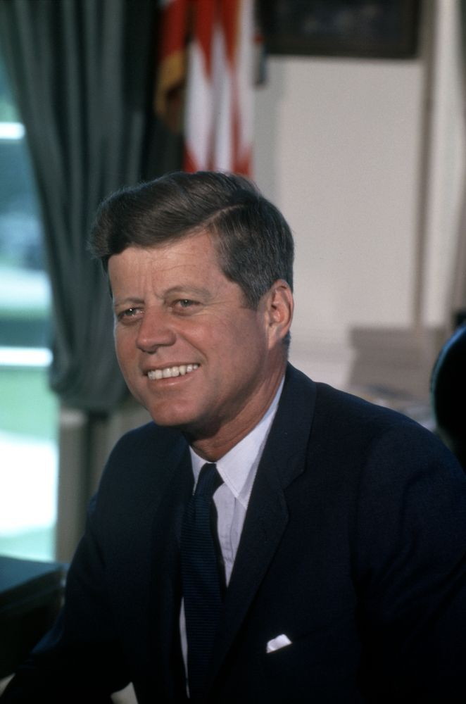 President John F. Kennedy portrait photograph, taken in the Oval Office, White House, Washington, D.C. July 11, 1963.